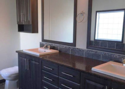 His & Her Sinks with Accent Tile and Framed Mirror